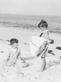 Two Boys Wearing Sailor Suits on Beach, One Holding Toy Sailboat Photographic Print by H. Armstrong Roberts