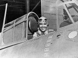 Smiling WWII Navy Pilot Sitting in Cockpit Photographic Print by H. Armstrong Roberts