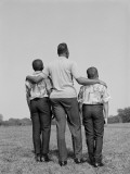 African-American Father With Arms Around Two Sons, Rear View Photographic Print by H. Armstrong Roberts