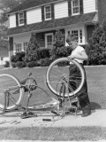 Boy Outside Front of House, Bicycle Upside Down, Spinning Front Wheel Photographic Print by H. Armstrong Roberts