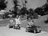 Boy and Two Girls on Suburban Sidewalk, Riding Tricycle and Toy Cars Photographie par H. Armstrong Roberts