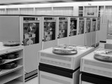Office Interior With Rows of Large Computer Disk Drive Machines Photographic Print by H. Armstrong Roberts