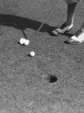 Putting Green With Feet in Golf Shoes Photographic Print by H. Armstrong Roberts