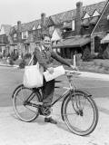 Paperboy on Bicycle in Suburban Neighborhood Photographic Print by H. Armstrong Roberts