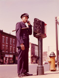 Police Officer Using Telephone at Street Police Callbox Photographic Print by H. Armstrong Roberts