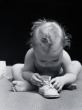 Baby Leaning Over Playing With Shoe Photographic Print by H. Armstrong Roberts