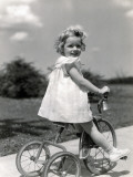 Girl on a Tricycle Lámina fotográfica por H. Armstrong Roberts