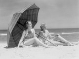 Two Women Sitting on Beach Under Parasol Photographic Print by H. Armstrong Roberts