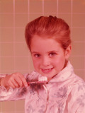 Girl, Wearing Bathrobe, Brushing Her Teeth in Bathroom Photographic Print by H. Armstrong Roberts