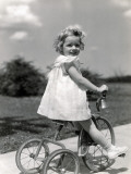 Girl Wearing Summer Dress, Riding Tricycle Down Sidewalk Photographic Print by H. Armstrong Roberts