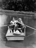 Boy and Girl in Row Boat on Lake, Each Rowing With an Oar Photographic Print by H. Armstrong Roberts