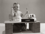 Baby at Desk Playing Loan Officer Photographic Print by H. Armstrong Roberts