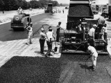 Road Construction Workers Using Machine To Lay New Asphalt on Road Photographie par H. Armstrong Roberts
