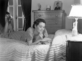 Woman Lying on Bed Reading Letter Photographic Print by H. Armstrong Roberts