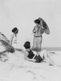 Three Young Women on Beach, Two in Swim Suits, Other Wearing Dress and Carrying a Parasol Fotografisk trykk av H. Armstrong Roberts