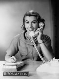 Female Telephone Receptionist at Information Desk, Answering Phone Photographic Print by H. Armstrong Roberts