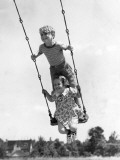 Boy and Girl on Swing Photographic Print by H. Armstrong Roberts
