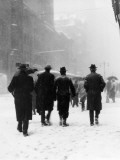 Pedestrians in Winter Snow, Walking Away From the Camera, Wearing Hats and Boots Photographic Print by H. Armstrong Roberts