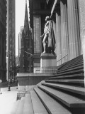 Statue at Steps in Front of Building, Wall Street, Trinity Church in Distance, New York City Photographic Print by George Marks