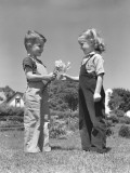 Boy Giving Bouquet of Daisies To Little Girl Photographic Print by H. Armstrong Roberts