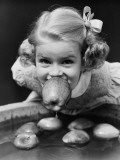 Girl Bobbing Apples at Halloween Party Photographic Print by H. Armstrong Roberts
