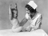 Nurse and Naked Baby With Hands Raised Lámina fotográfica por H. Armstrong Roberts
