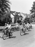 Group of Seven Children Riding Bicycles Along Suburban Street Photographic Print by H. Armstrong Roberts