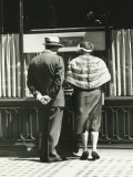 Man and Woman Looking at Window Display in Retail Store, Rear View Photographic Print by George Marks