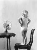 Naked Girl Standing on Chair, in Front of Fan, Arms Akimbo Photographic Print by H. Armstrong Roberts