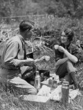 Couple Sitting in Grass, Having Picnic Photographic Print by H. Armstrong Roberts