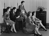 Five People Watching Home Movies, Seated Around Projector, Looking Toward Screen Photographic Print by H. Armstrong Roberts