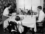 Family Seated Dinner Table, Mother Standing, Holding Birthday Cake Photographie par H. Armstrong Roberts