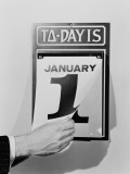 Man's Hand Tearing January 1 Page Off of Daily Wall Calendar Photographic Print by H. Armstrong Roberts