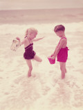 Boy and Girl Playing in Ocean Surf Photographic Print by H. Armstrong Roberts