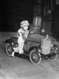 Girl in Toy Pedal Car With Dog Sitting on Running Board Fotografisk tryk af H. Armstrong Roberts