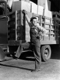 Truck Driver Dressed in Overalls Resting Foot on Cab of Truck Photographie par H. Armstrong Roberts