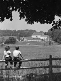 Boy and Girl Sitting on Fence, Overlooking Farm Fields Photographic Print by H. Armstrong Roberts