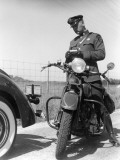 Policeman on a Motorcycle Writing a Ticket From Information on the Vehicles License Photographic Print by H. Armstrong Roberts