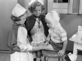 Two Young Girls Dressed As Nurses, Bandaging Three Year Old Boy's Head and Foot Photographic Print by H. Armstrong Roberts