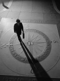 Silhouetted Businessman With Briefcase Walking Across Compass in the Sidewalk Photographic Print by H. Armstrong Roberts