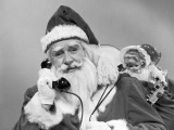 Santa Claus on the Telephone With His Sack of Toys Reproduction photographique par H. Armstrong Roberts