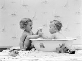 Baby Boy Sittings in Wash Tub, Washing Feet of Girl Sitting Outside of Tub Fotografisk tryk af H. Armstrong Roberts
