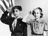 Boy and Girl Scouts Saluting, American Flag in Background Photographic Print by H. Armstrong Roberts