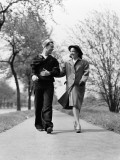 Couple Walking Outdoors, Man Wearing Sailor Uniform, Woman Wearing Coat, Hat and Gloves Photographic Print by H. Armstrong Roberts
