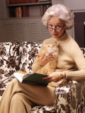 Woman Reading Book, Holding Orange Tabby Cat Photographic Print by H. Armstrong Roberts
