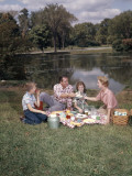 Retro Family Sitting Together Enjoying Picnic Food Photographic Print by H. Armstrong Roberts