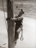 Utility Worker Man is Climbing Electric Power Utilities Pole Photographie par H. Armstrong Roberts