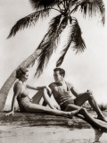 Smiling Couple Under Palm Tree Bathing Photographic Print by H. Armstrong Roberts