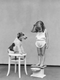 Girl Standing on Scales, Reading Weight, Terrier Dog Sitting on Stool Photographic Print by H. Armstrong Roberts