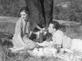 Couple Under Tree Having Picnic Photographic Print by H. Armstrong Roberts